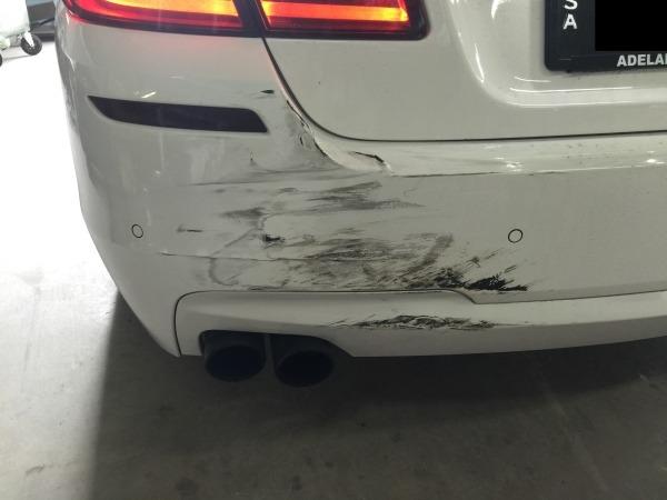 BMW rear bar dented BEFORE