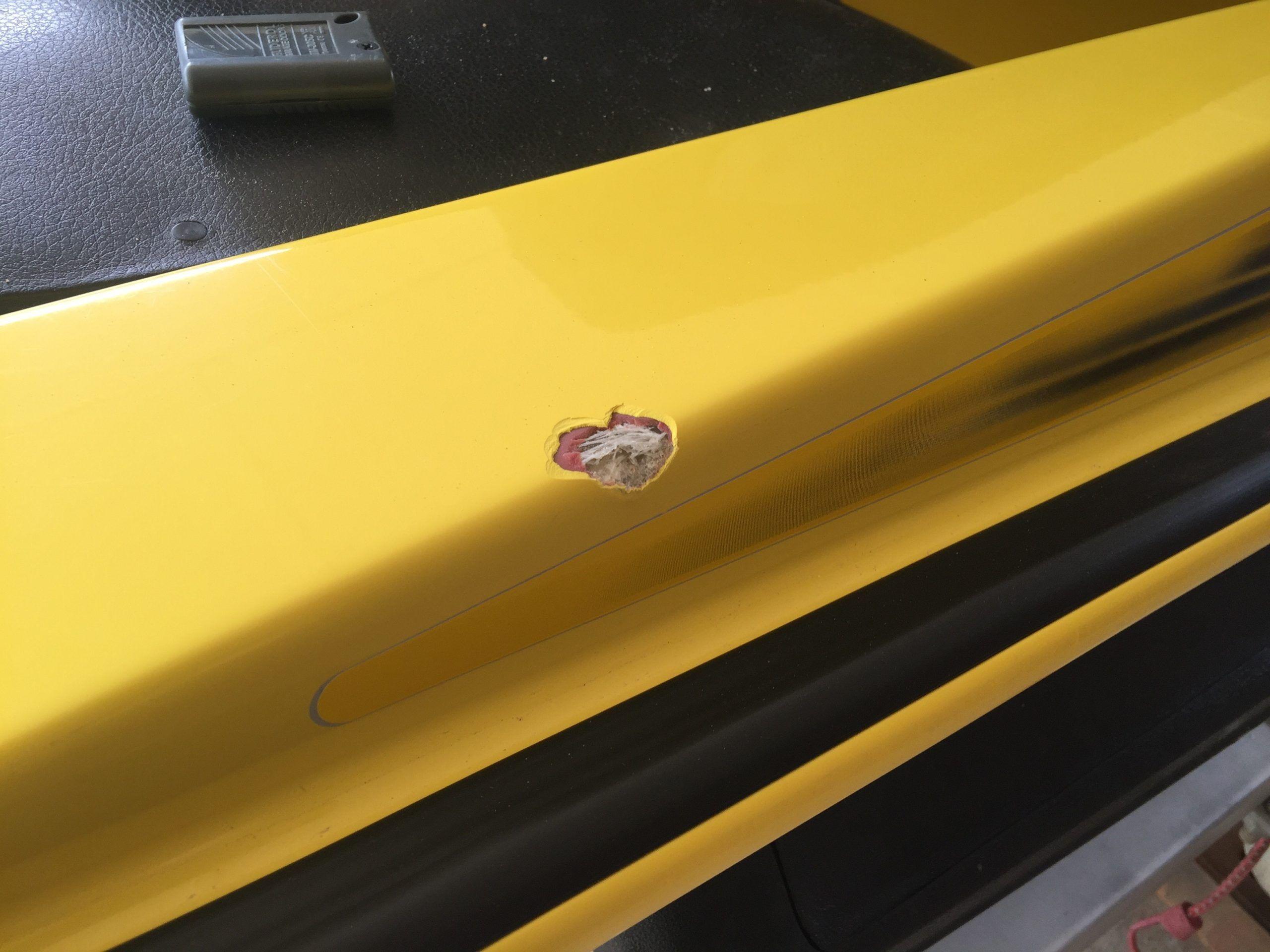Jetski paint chip repair BEFORE close up