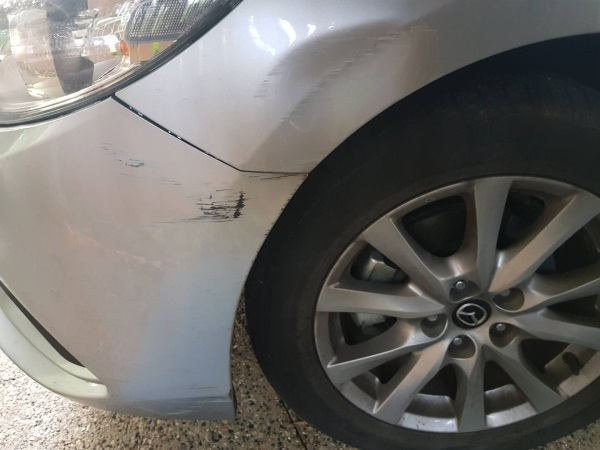 Mazda Guard Dent - Before