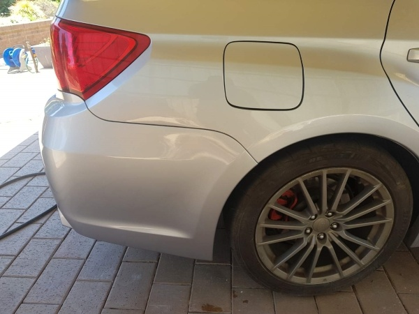 Subaru WRX guard dent - After