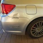 Subaru WRX guard dent - Before