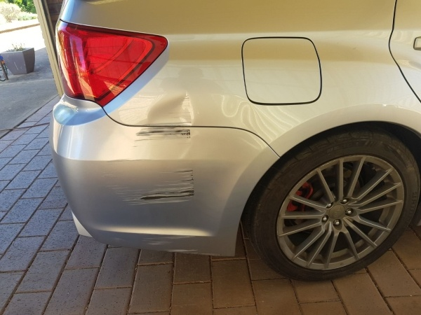 Subaru WRX guard dent - Before