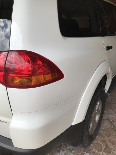 Dent in Rear Guard - Before
